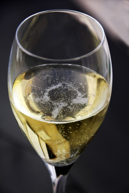 Champagne, a sparkling wine produced from grapes grown in the Champagne region of France