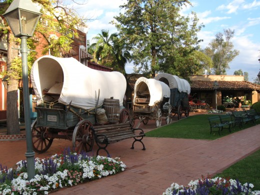 Antique covered wagons parked along the street in Tucson Arizona's Trail Dust Town