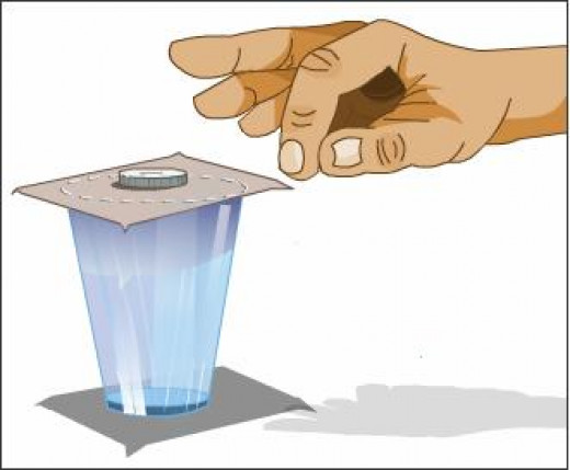 When you flick the cardboard with finger, the coin does not move with the flick of the finger, rather it falls down. Thus, it maintains its position.