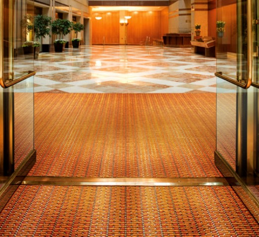 Aesthetic specialty entrance flooring solutions can be customized to match main floor.