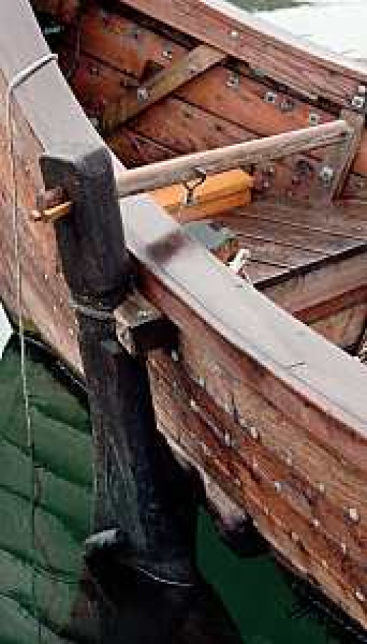 The steering oar or tiller aft on the right side of the ship - this is the side formerly known as 'steerboard', nowadays 'starboard'