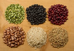 An assortment of beans, along with rice. A combination of rice and beans provides a complete protein. Beans provide fiber, potassium, folate, iron, manganese and magnesium, and they are cholesterol- and fat-free.