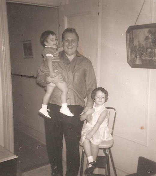 My dad, me (obviously the one he is carrying) and my sister. 1963