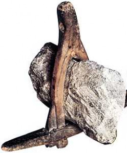 Stone-weighted anchor, for use in shallow, sheltered waters such as a fjord or inlet