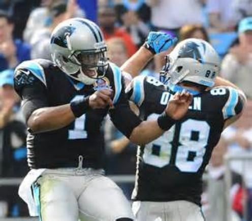 Cam Newton celebrates with his favorite passing target Greg Olsen.