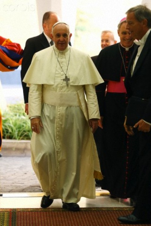 Pope Francis enters an arena to make speech to believers