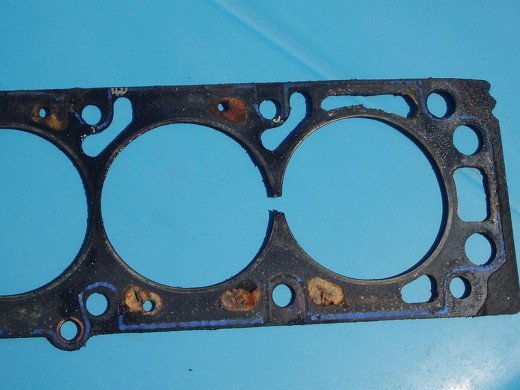 A damaged head gasket can contaminate engine or transmission oil.