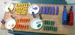 painting the blocks purple green orange and yellow
