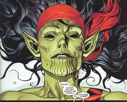 """Fury pulled back the sheet to reveal a green female with pointed ears and several slits in her chin in Elektra's clothing."""