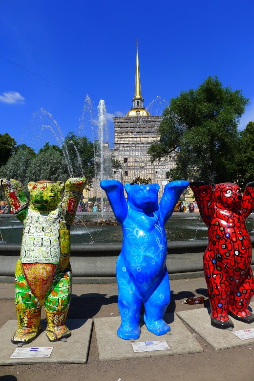 The Buddy Bears on display at St. Petersburg. In the background is the Admiralty.