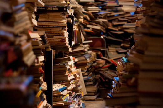 This is what a book hoard most often looks like. There is little organization, no shelving, and the books are stacked from floor to ceiling.