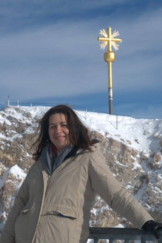 Me at the summit of the Zugspitze (the Wetterstein Mountains of the Alps) on the border of Germany and Austria.  The Summit Cross is behind me.