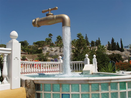 The magic tap in Aqualand,Spain.The tap appears to float in the sky with an endless supply of water. Actually, there is a pipe hidden in the stream of water that holds the whole structure.