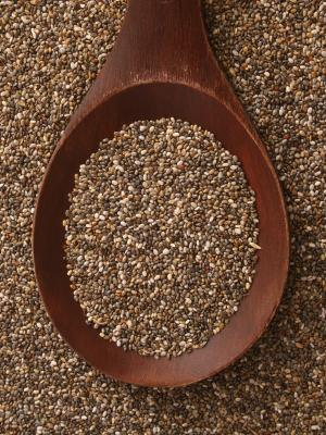 Chia seeds on a wooden tablespoon