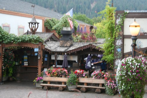 Local pub situated in the back with beautiful flowers at the entrance