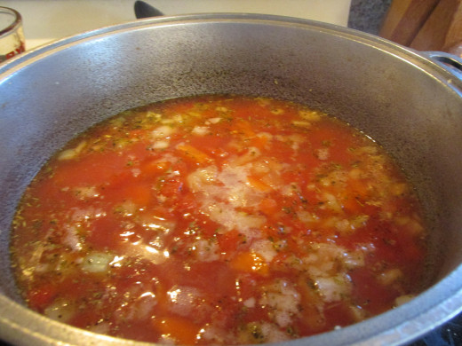 With tomatoes and broth and water added.