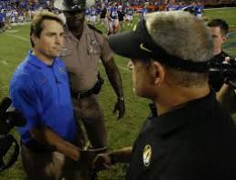 Then-Florida Gator, head coach, Will Muschamp (left) and Gary Pinkle, head coach, Missouri Tigers