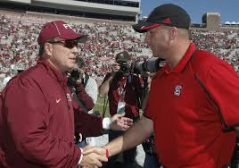 FSU's, Jimbo Fisher, left, North Carolina State's, Dave Doeren
