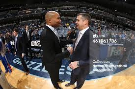 NBA coaches, Derek Fisher and David Joerger shake hands after a good game