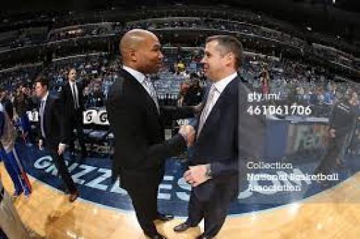 NBA coaches, Derek Fisher and David Joerger shake hands after a good game