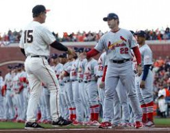 San Franciso Giants Bruce Bochey greets St. Louis Cardinals', Mike Mathney