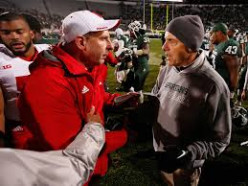 Then-Nebraska Cornhusker, head coach, Bo Pellini consoles Michigan State's, Mark Dontonio