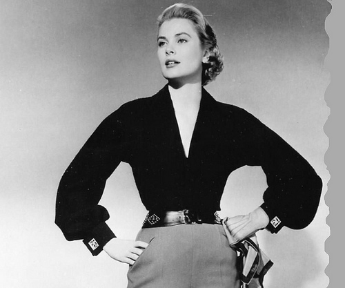 Grace Kelly, looking powerful and timeless in a deep-v blouse