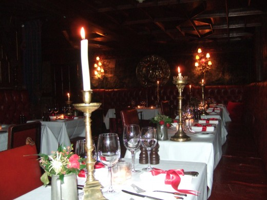 The Witchery. Each brass candle is slightly different. One of many 'touches'.