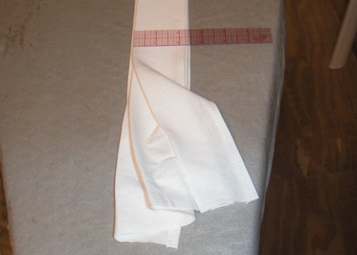 Fold the hemmed fabric lengthwise like a fan.