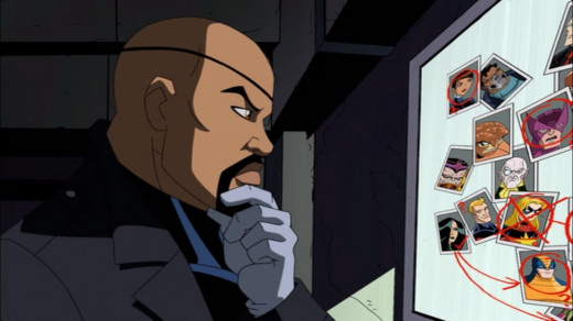 """Nick Fury stood in front of a bulletin board with pictures of various heroes on it."""