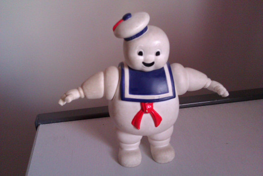 This is a picture of my very first Ghostbusters toy, a Stay-Puft Marshmallow man figurine.