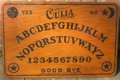 Ouija Boards are thought to be a portal to communicating with the dead. Two or more people participate in an underground, secretive  type ritual.