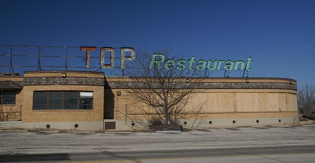 This is a sad photo of an abandoned truck stop that for some reason went bust