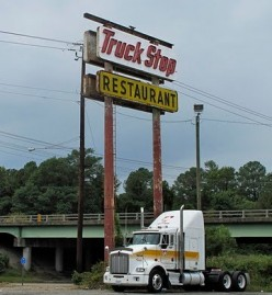 What a tall sign that serves as good advertising to the truckers