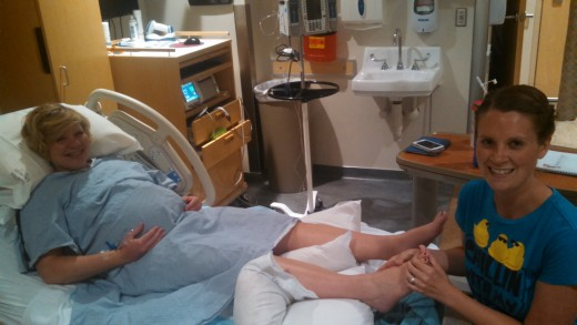 This is me working on my sister-in-law's feet at the hospital. I gave her a foot zone the day before, and after her water broke, she wanted an additional foot zone to try to speed up labor.