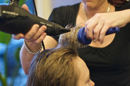 Blow dry with a round brush to create lift and body