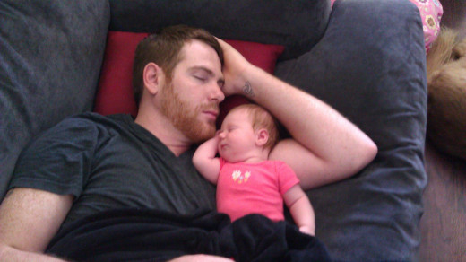 Father sleeping with his baby
