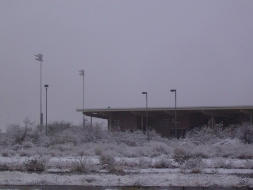 The athletic center sits deserted in the middle of snow covered desert.  No work-out for me today.