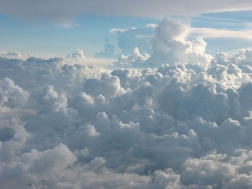 Try reading the clouds from above, while riding on a plane...it's a very surreal and ethereal experience you won't forget!