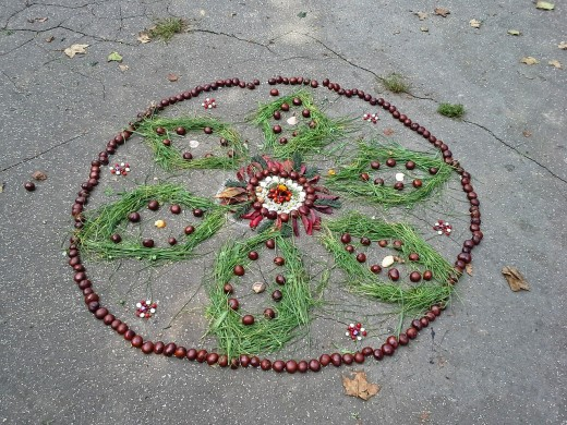 Mandalas can be etched on a sandy beach or drawn using natural elements such as stones, leaves, grass, seeds, and flowers.
