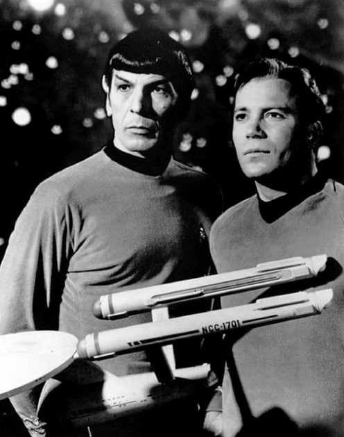 Leonard Nimoy as Science Officer Spock and William Shatner as Captain James Tiberius Kirk with a model of the Enterprise NCC-1701.