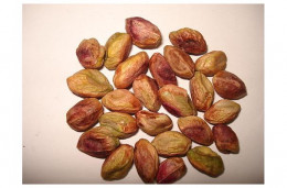 Shelled pistachio kernels with purple-brown skins