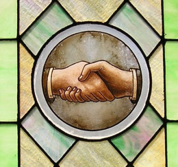 hand shake poster in a stained glass frame