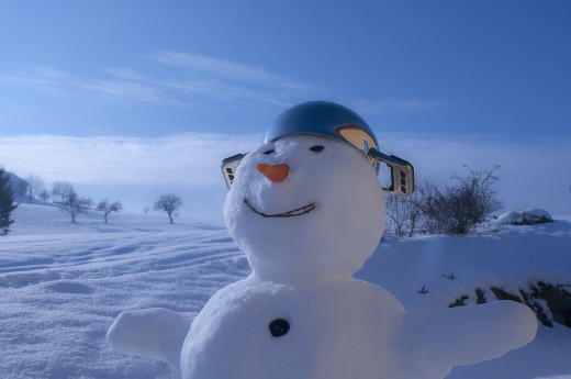 "If the snow is getting you down, building a snowman is the perfect ""pick-me-up""!"