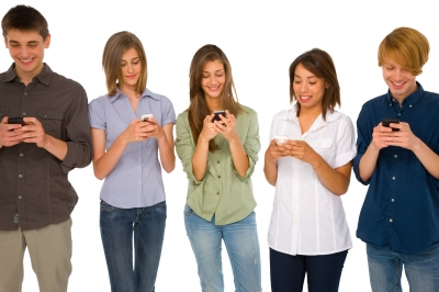 Teens using cell phones.