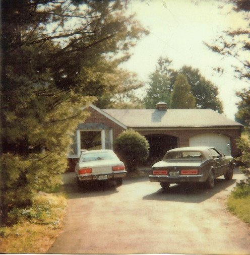 The two car garage was added by matching the exact brick to make it look as if it was built originally