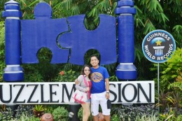 Me and my wife in front of puzzle mansion