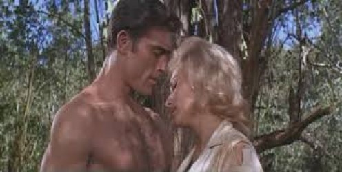 Tarzan/Mike Henry, consoles a woman in trouble in the jungle