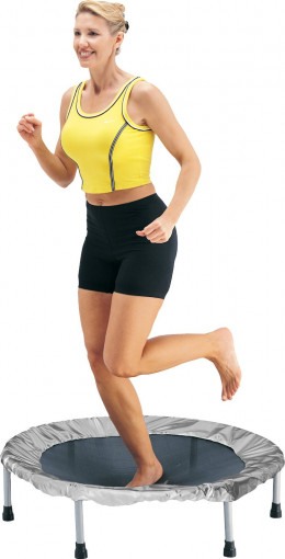 A woman jumping or rebounding on a mini trampoline.
