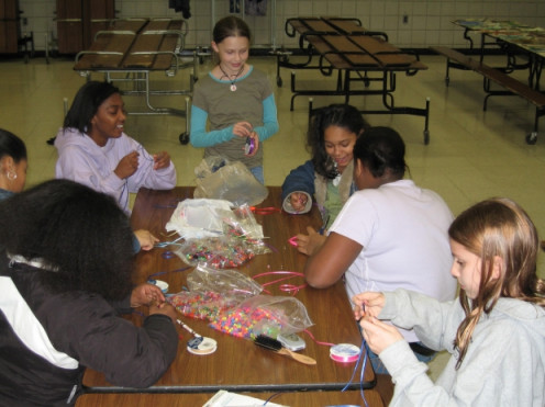 Girl scouts meeting in a modern venue to learn crafts.